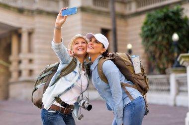 Female tourists taking self portrait