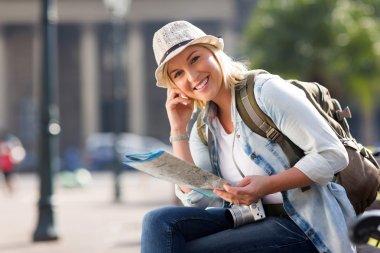 Female traveller holding map
