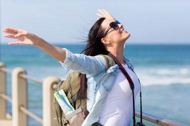 Tourist standing on pier