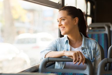 Woman taking bus to work