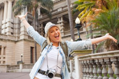 Cheerful tourist arms up