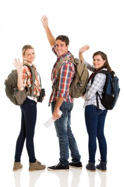 Group of young tourists waving goodbye