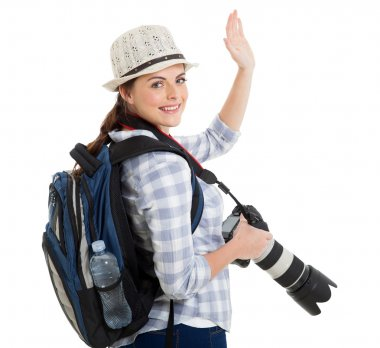Young tourist waving good bye