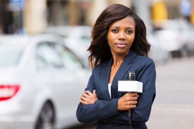 Young african female news reporter