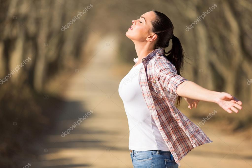 Young woman with arms outstretched