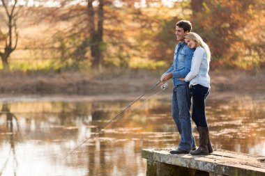 young couple fishing together