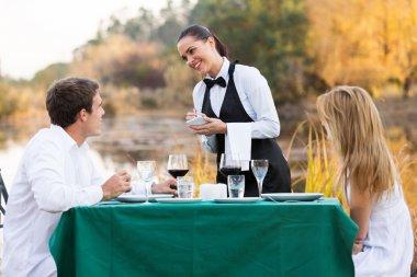 Waitress taking order from customer