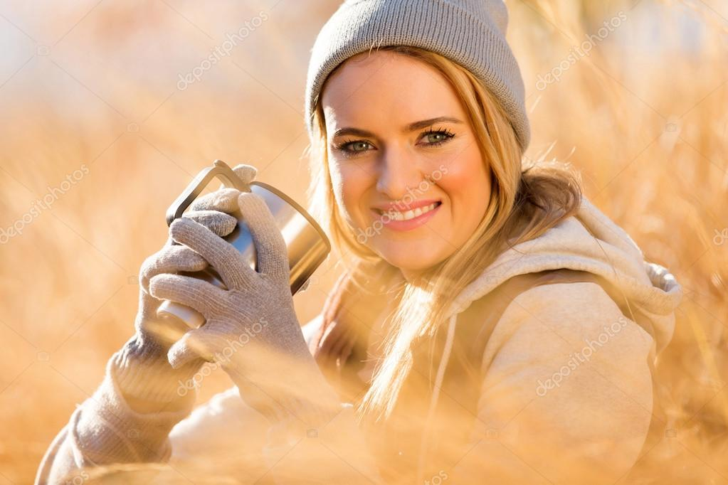 young woman warming up with coffee