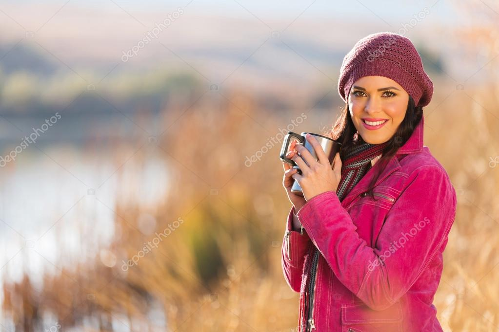 Woman warming up with hot coffee