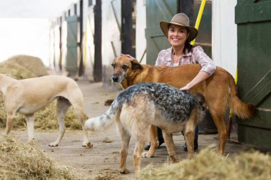 female horse stables owner and dogs