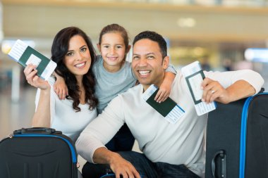 Family holding boarding pass