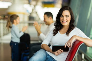 Woman holding tablet at airport
