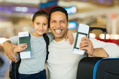 Father and daughter at airport