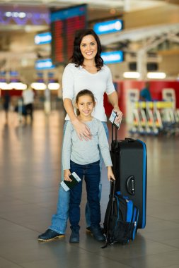Mother and daughter with luggage