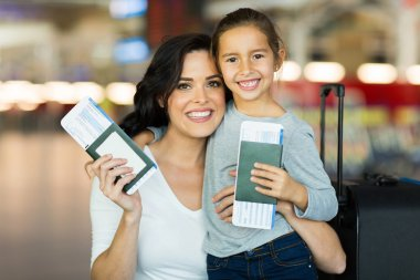 Mother and daughter holding passports