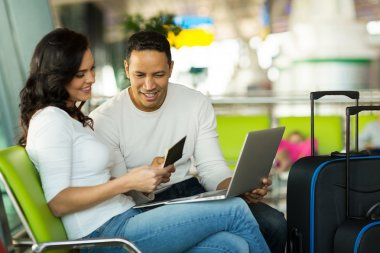 Couple checking flight information