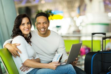 Couple with laptop at airport