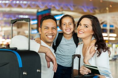 Couple with daughter at airport