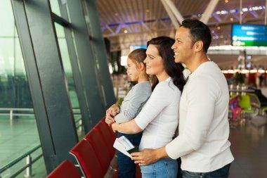 Family waiting at airport