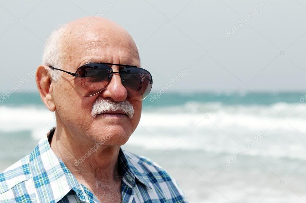 handsome mature men on the beach