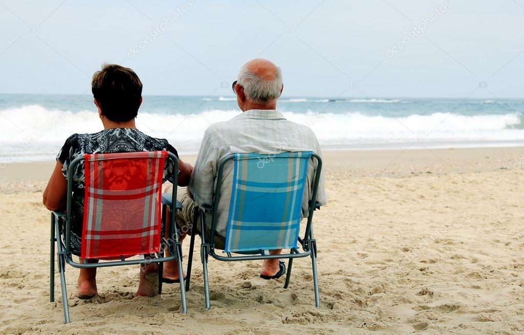 Backview of senior couple on sandy beach