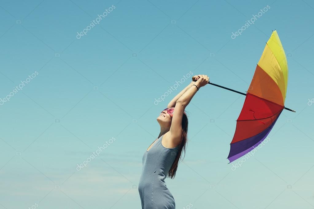 Model holding umbrella