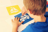 Fotografie 6 years old boy drawing
