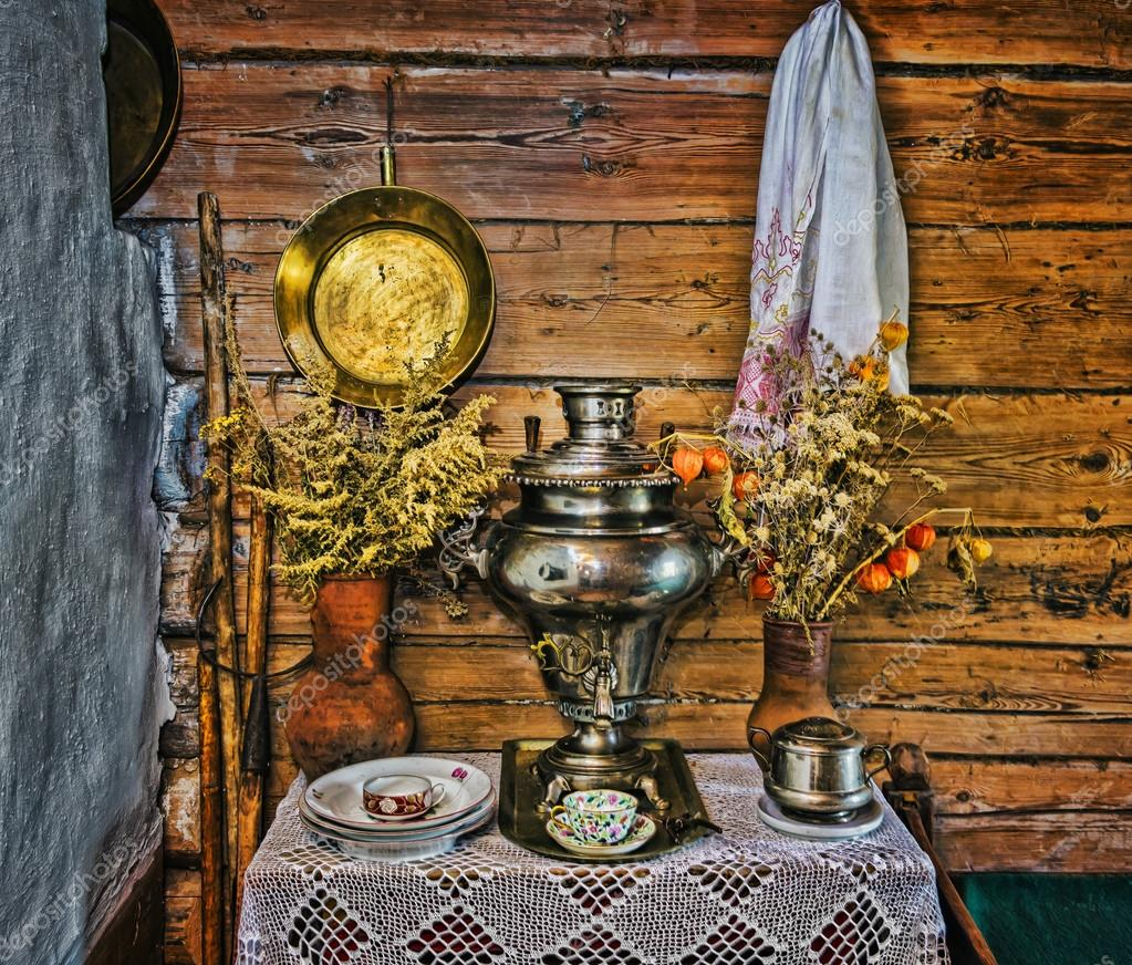 interior of russian log hut with elements of the old way of li