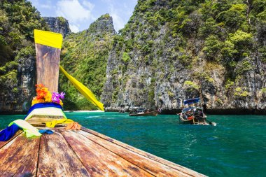 Boats at sea against the rocks in Thailand