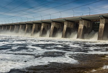 Water pouring through sleus gates at dam