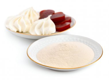 Agar-agar powder on a white plate. On a background Zefir and fru