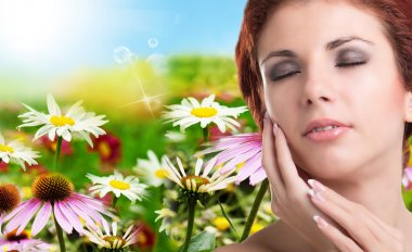 Beauty Woman Portrait. Beautiful Spa Woman Touching her Face.