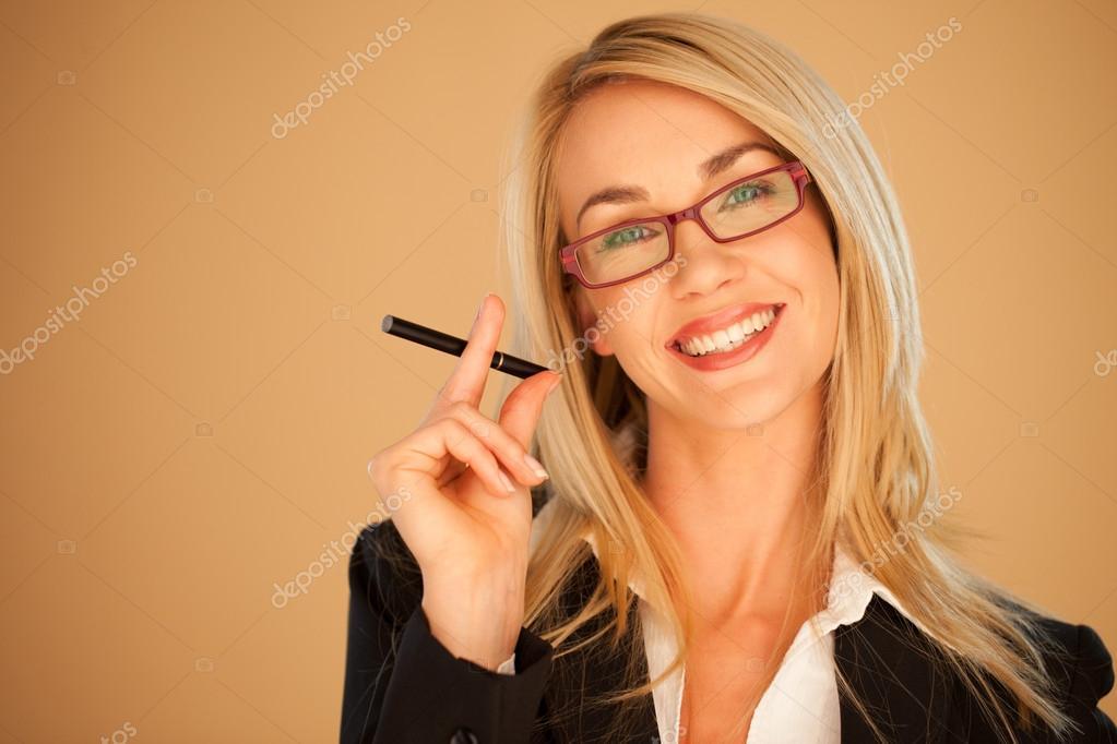 Attractive professional woman smoking — Stock Photo