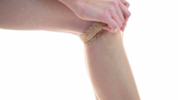 Woman putting on stockings