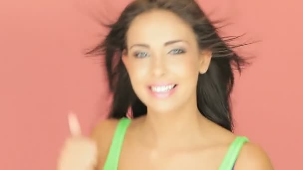 Beautiful brunette giving a thumbs up