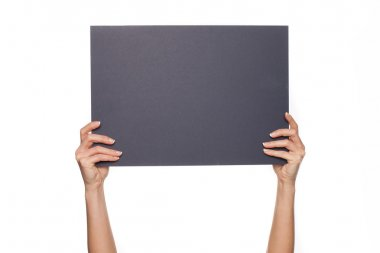 Cropped shot of extend female ares holing up a blank chalkboard, over white background with space for text stock vector
