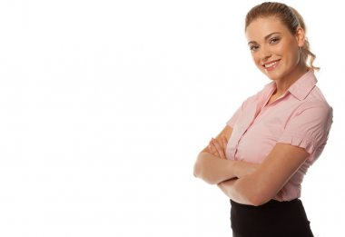 Smiling business woman with arms folded