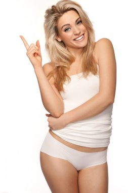 Beautiful blonde woman pointing upwards