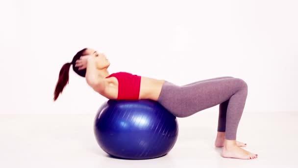 Pilates se posadit na cvičení