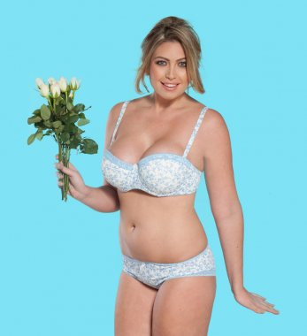 Woman in lingerie carrying flowers