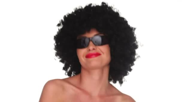 Smiling woman with an afro hairstyle