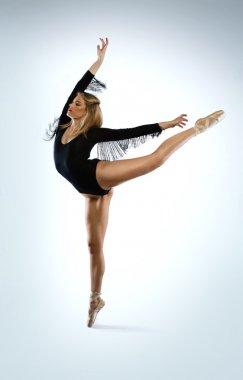 Beautiful ballet dancer doing an arabesque