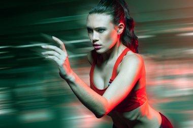 Female sprinter running at speed