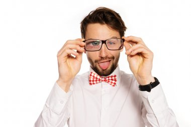 Goofy businessman sticking out his tongue