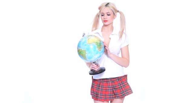 Beautiful cute blond woman holding a globe