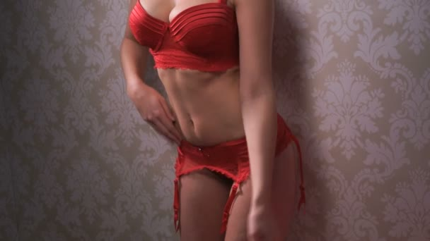 Sexy blonde woman wearing red lingerie camera