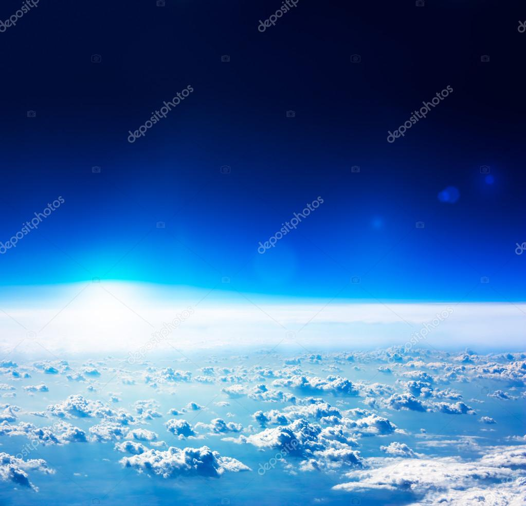 Earth Aerial View. Dark Blue Sky and Clouds.