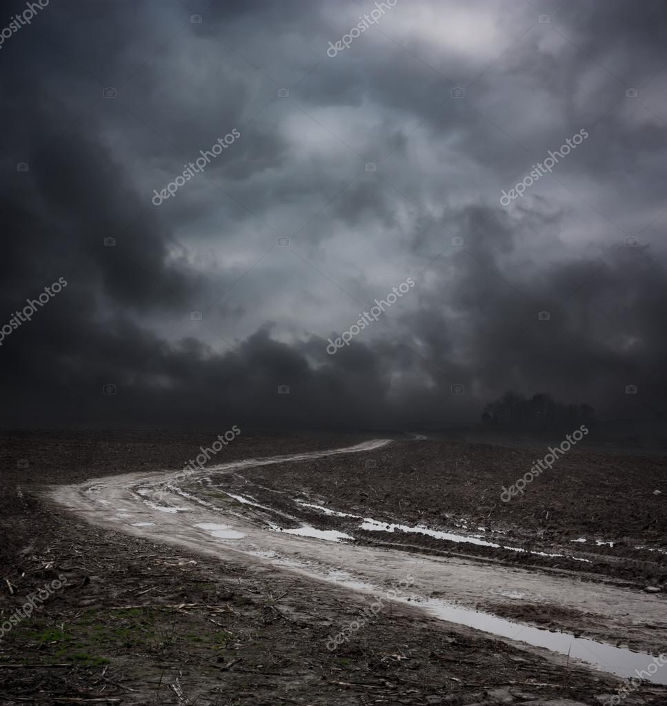 Dark Landscape with Dirty Road and Moody Sky