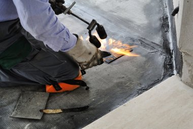 Man applying waterproof coating