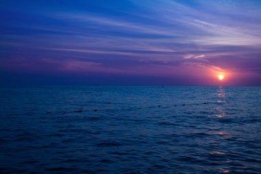 Sunset over crystal blue ocean